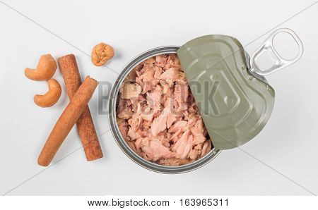 canned tuna isolated on white background / Canned soy free albacore white meat tuna packed in water / open tuna tin on a white background / tuna fish isolated on white