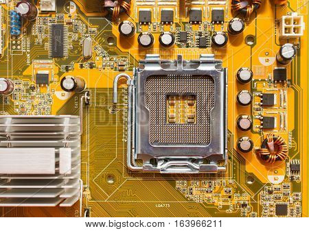 close view at empty processor socket on computer motherboard - top view