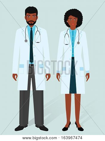 Hospital staff concept. Man and woman african american doctors in medical gowns. Medical people. Flat style vector illustration.
