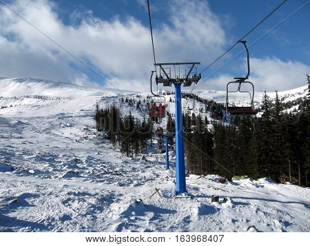 People go on the chairlift ski lift in the mountains Dragobrat that would go skiing