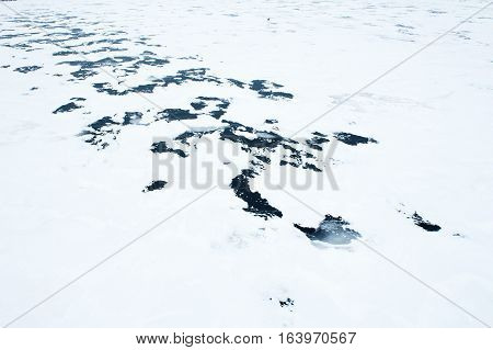 image of river with ice on it in winter
