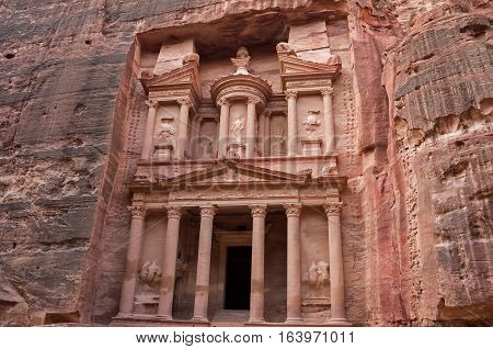 Ancient nabataean temple Al Khazneh (Treasury) located at Rose city - Petra, Jordan. View from Siq canyon.