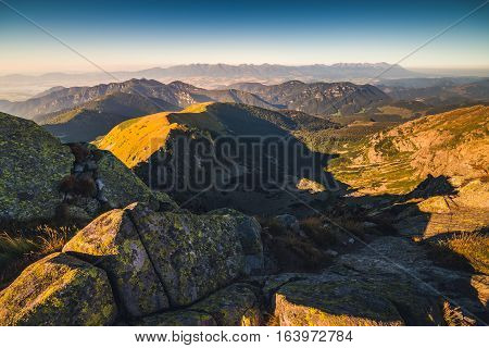 Evening Mountain Landscape with Rocks in Foreground. View from Mount Dumbier in Low Tatras National Park Slovakia.