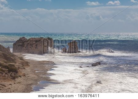 View of Aphrodite's rock at Kouklia Cyprus.  A seascape with a rough sea.  Waves crashing onto the large rocks.