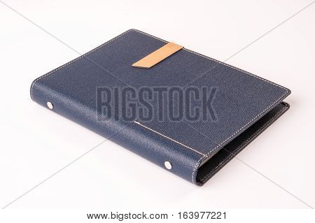 Dark blue colored organizer book on white background.