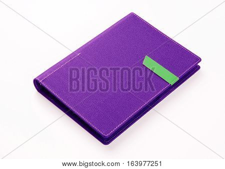 Purple colored organizer book on white background