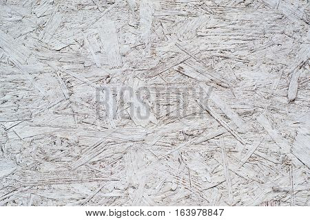 white painted plywood glued of large particles