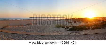 Panoramic of a beach in Algarve, Portugal during sunset