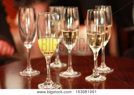 Champagne Flutes With Champagne And Bucks Fizz