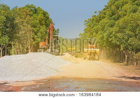 Excavator loader machine during earthmoving works street at construction site with sunlight