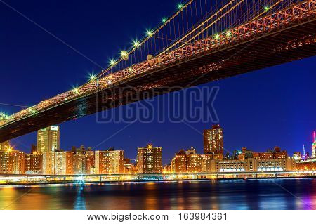 Spectacular skyline of Downtown Manhattan including the Brooklyn Bridge Brooklyn bridge in New York at night