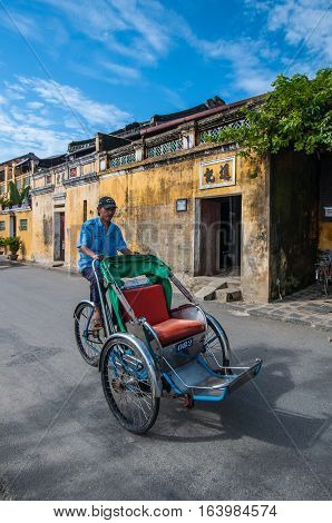 Hoi An, Vietnam - December 12: A classical rickshaw is serviced for city touring on December 12, 2011 in Hoi An, Vietnam.