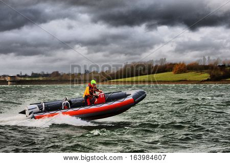 A rigid inflatable boat RIB powering through waves