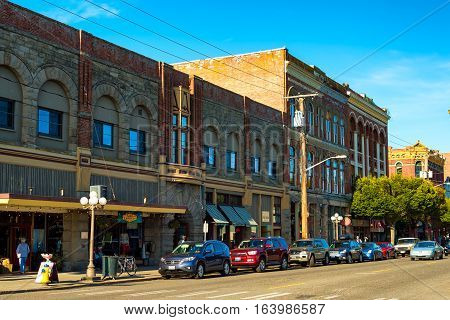 PORT TOWNSEND WA - SEPTEMBER 15 2016: Old buildings along Water Street in this historic town on Washington's Olympic Peninsula retain a vintage appeal.