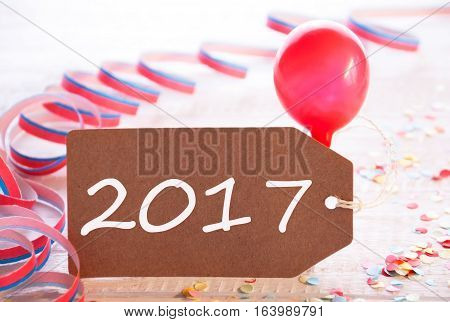 One Label With Text 20107 For Happy New Year Greetings. Party Decoration Like Streamer, Confetti And Balloon. Wooden Background With Vintage, Retro Or Rustic Syle