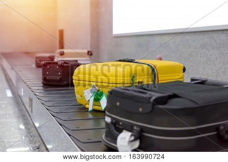 Suitcase Or Luggage With Conveyor Belt In The Airport