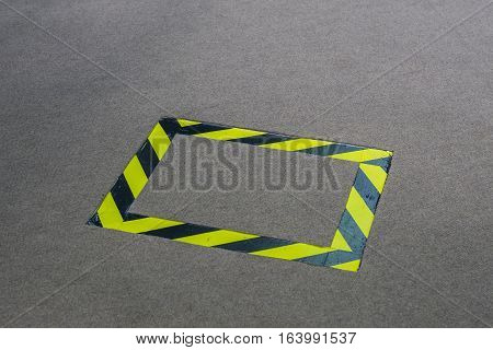 black and yellow tape placed on the carpet for avoiding any accident while walking.