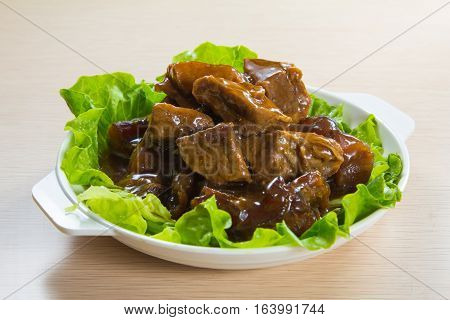a cuisine photo of braised beef belly