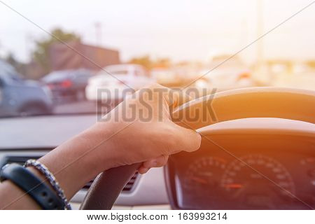 Close Up Hands Of A Driver On Road