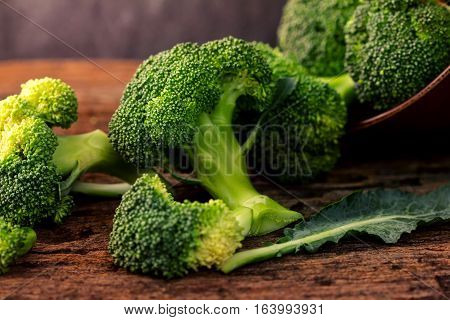 The selective focus fresh green broccoli on wooden plate