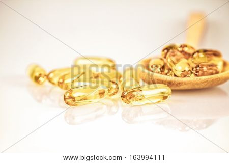 Closeup the yellow soft gelatin supplement fish oil capsule