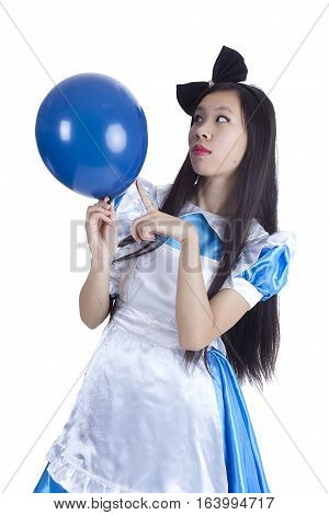 Young girl in the image of Alice with blue ball