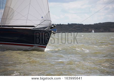 yachts sailing on the sea in windy conditions