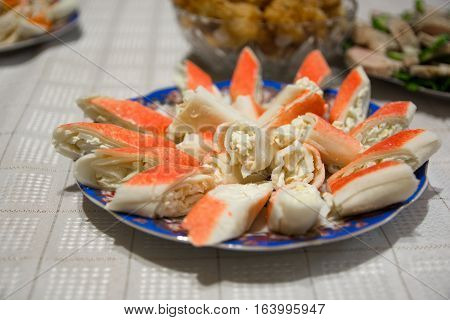 Stuffed appetizer. It is made from crab sticks and cheese.