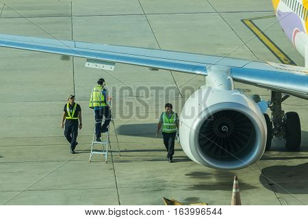 BANGKOK, THAILAND - DEC 29 2016. airport officer and truck Refueling of the aircraft at Don Mueang international airport (DMK)