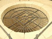 Grid/grill on a well. Well. Shape. Old/ancient construction. Roman ruins in old Acre city in Israel poster