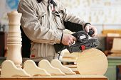 Man doing woodwork in a carpentry. Woodworker poster