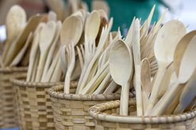 Wooden baskets full of handmade wooden spoons.