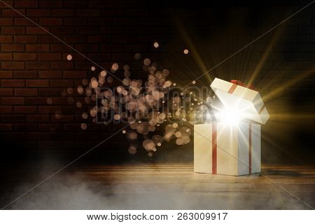 Gift with an open lid lit as a surprise at Christmas (3D Rendering)