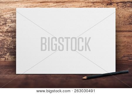 Blank Banner White Paper Poster Leaning At Grunge Wood Wall On Wooden Floor In Perspective Room,busi