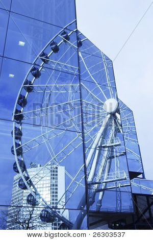 reflection of ferris wheel at Birmingham symphony hall