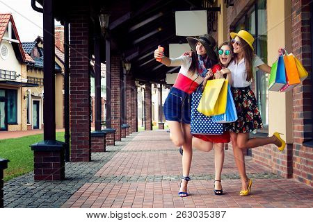Pretty Happy Bright Women Female Girls Friends In Colorful Dresses, Hats And High Heels With Shoppin