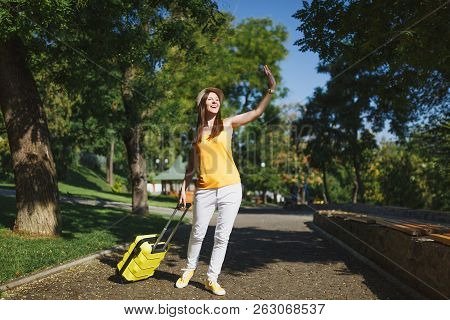Young Laughing Traveler Tourist Woman In Hat With Suitcase Waving Hand For Greeting Meeting Friend W