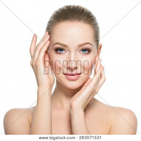 Beautiful face of young smiling woman with  health skin  - isolated on white.  Skin care concept. Female Model touches face.