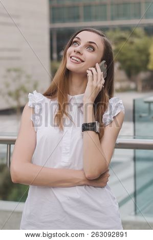 Young European Female Talking Via Mobile Phone With Very Surprised And Astonished Face Expression. P