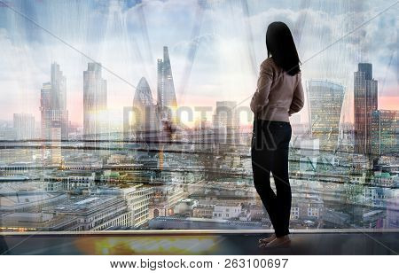 Young Woman Looking Over The City Of London At The Early Morning Time. Future, New Business Opportun