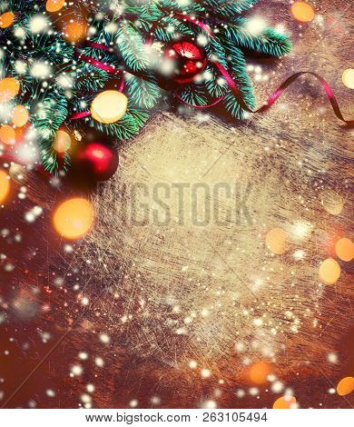 Christmas Background With Festive Decoration, Pine Tree Branch, Snowflakes And Bokeh Lights On  Dark