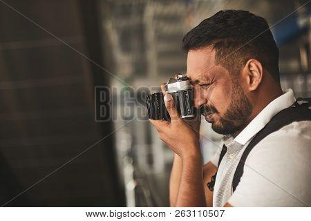 Close Up Of A Pleasant Hindu Man Making Photos