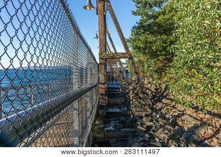 A View Of A Walkway Along A Pier At Jack Block Park In West Seattle, Washington.