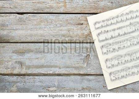 Sheets With Musical Notes And Copy Space. Musical Papers On Old Wooden Background. Classic Music Con