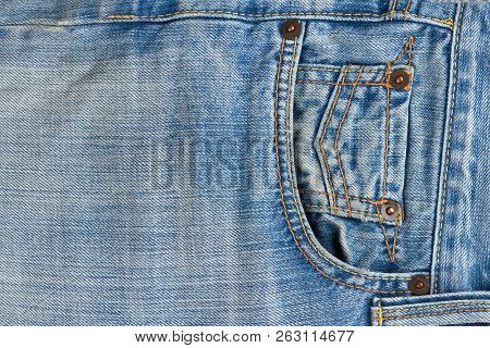 Close Up Of Denim Jeans Texture With Seams. Pocket Of Brand Jeans. Part Of Blue Classic Jeans Close