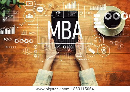 MBA with a person holding a tablet computer poster