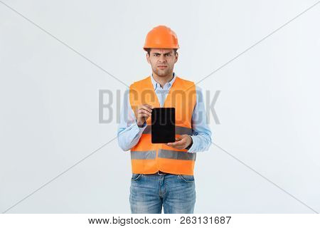 Serious Engineer Man Holding Tablet And Checking Project , He Feel Unhappy And Serious From Project.