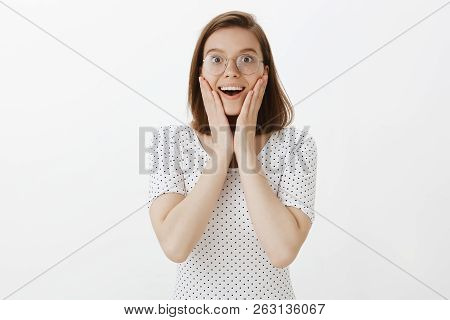 Waist-up Shot Of Thrilled Good-looking European Woman In Eyewear, Smiling Broadly, Being Charmed And