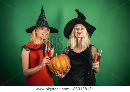 Attractive Models Girls In Halloween Costume. Halloween Girls With Pumpkin. Best Friends Girls Celeb