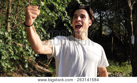 Young Man Exulting Happy In Nature, Standing
